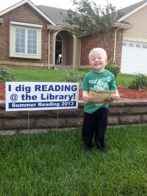 Ben with his summer reading sign last year.
